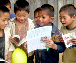 Children in rural Laos, with their first book